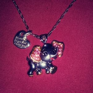 Necklace with elephant & heart pendant.